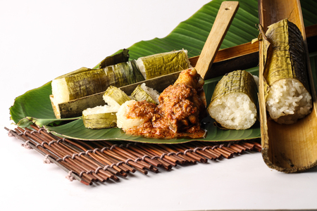 malay lemang served with rendang ayam