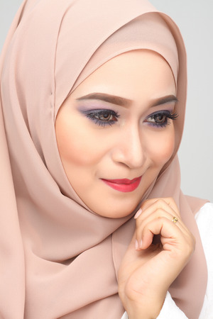 young asian muslim woman with expression wearing hijab