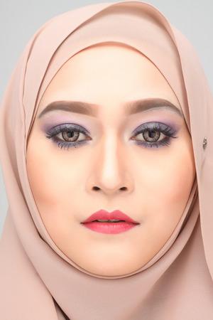 paranja: young asian muslim woman with expression wearing hijab