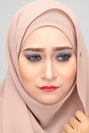 burqa: young asian muslim woman with expression wearing hijab