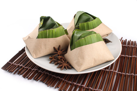 keropok: traditional fresh Malaysian nasi lemak packed with banana leaf in white background Stock Photo