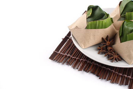 lemak: traditional fresh Malaysian nasi lemak packed with banana leaf in white background Stock Photo