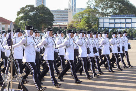 newsworthy: KUALA LUMPUR - NOV 7 : Newly grad Malaysian Cadet Inspector doing a parade run to complete their nine month training on November 7, 2015 at PDRM Training Centre Kuala Lumpur Malaysia.