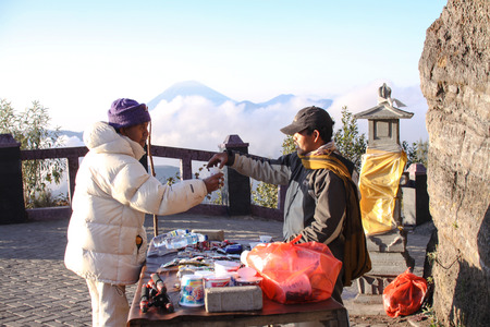 tengger: BROMO, INDONESIA - NOVEMBER 17: A local sells coffee at Bromo Tengger Semeru National Park. Tourism is one of the main income for them in here 17 November 2015.