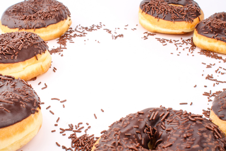 chocolate doughnuts with empty content space in the middle