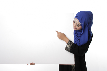 pelita: Malaysian asian malay woman holding an empty white board for content space isolated in white