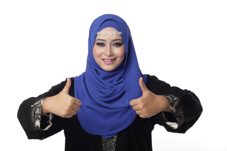 pelita: Malaysian malay woman showing good hand sign with smile expression Stock Photo