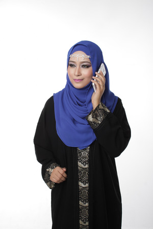 pelita: Malaysian malay woman using a cell phone or smartphone with different expression isolated in white