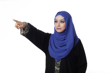 pelita: Malaysian malay woman giving or pointing a one sign with hand isolated in white Stock Photo