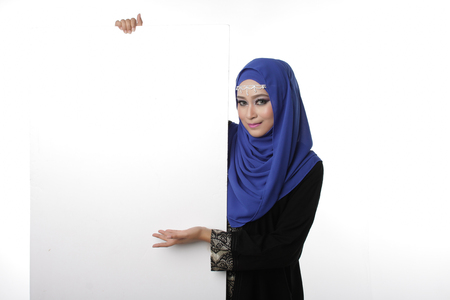 hari raya aidilfitri: Malaysian asian malay woman holding an empty white board for content space isolated in white