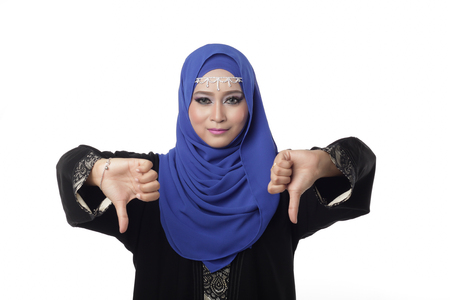 pelita: Malaysian malay woman showing a bad expression with a hand sign