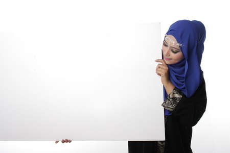 Malaysian asian malay woman holding an empty white board for content space isolated in white
