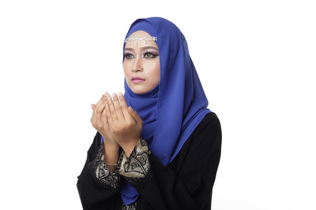 pelita: Malaysian malay woman praying isolated in white background