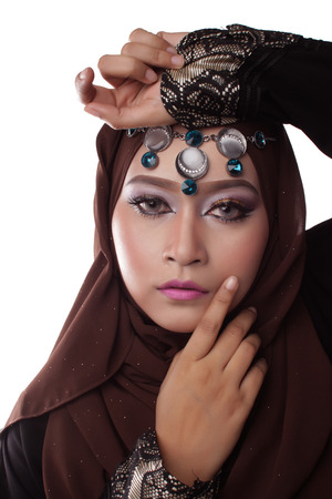 pelita: Malaysian malay woman posing with different normal and smiling expression with arabic theme look