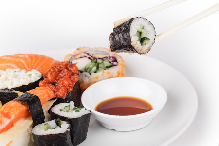 chop stick: shushi pick with chop stick with female hand Stock Photo