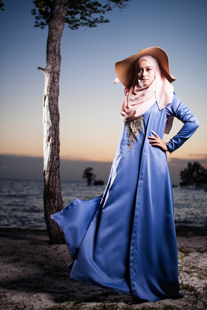muslim woman posing for fashion with beautiful sunset view