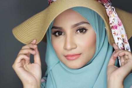 portrait of young asian beautiful muslimah woman posing for a camera