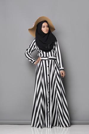 muslimah: Asian muslimah woman with beautiful attire on gray background