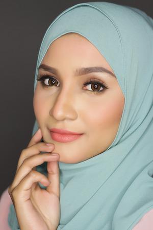 muslimah: portrait of young asian beautiful muslimah woman posing for a camera