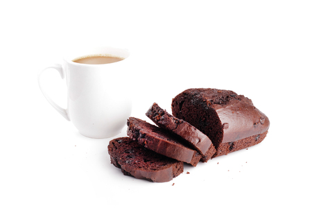 choc: choc chip sliced with a cup of white choc drink  isolated in white background