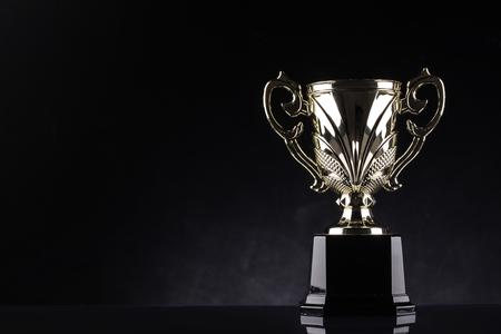 awards ceremony: award winning trophy shot in black background