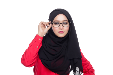 office attire: beautiful corporate muslimah woman with office attire red holding her spec Stock Photo