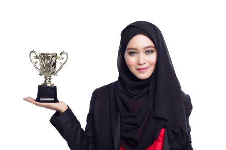 office attire: beautiful corporate muslimah woman with office attire holding a tropy Stock Photo