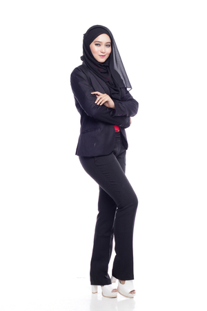 office attire: beautiful corporate muslimah woman with office attire crossing arm in white background