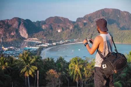 phi phi: man with sling bag viewing phi phi island from high view point