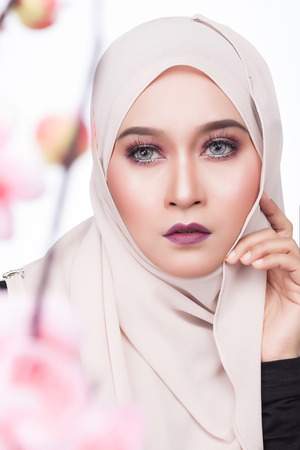close up shot of moslem asian woman beauty fashion shoot with natural expression and make up
