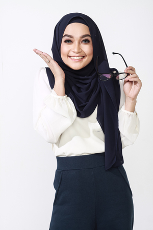 office attire: beautiful asian muslimah woman with office attire showing different expression