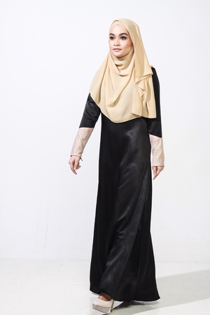muslimah: beautiful muslimah woman wearing full attire to cover her body in black and hijab