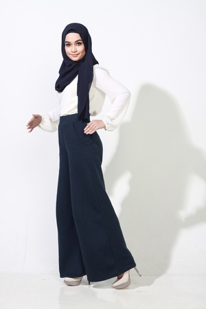 muslimah: beautiful asian muslimah woman model posing on white wall studio with different expression