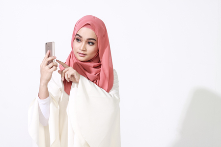 finger print: beautiful malay woman using latest mobile phone feature finger print