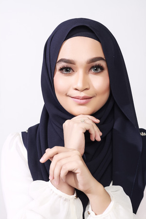 office attire: close up shot of beautiful asian muslimah woman with office attire showing different expression