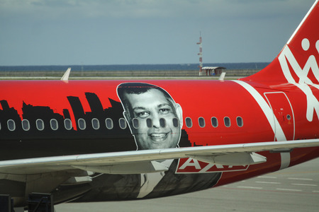 aluminum airplane: KLIA 2, MALAYSIA - 17 JULY 2016. Closeup view of Air Asia planes. Air Asia is one of the best airlines that offer cheap flight than Malindo Air Editorial