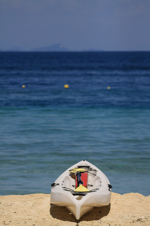 middle ages boat: kayak at white beach sand Stock Photo