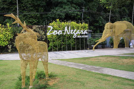 negara: KUALA LUMPUR, MALAYSIA - 26 JULY 2016. Zoo Negara entrance park. Zoo Negara have a total of over 5137 specimen from 476 species of mammals, birds, reptiles, amphibians and fish.