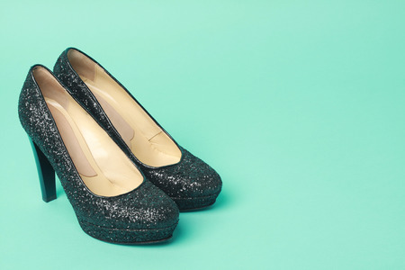 beautiful black heels in turquoise background