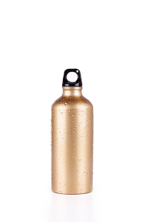 to maintain: gold steel bottle isolated in white background Stock Photo