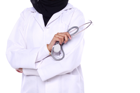 muslimah doctor holding a stethoscope isolated in white background Stock Photo
