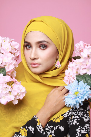 muslimah: muslimah model in fashionable dress isolated in pink background