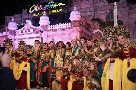 slow motion: Kuala lumpur 25 September 2016 , Citra Warna Malaysia was held at Dataran Merdeka. Performers taking picture infront of dataran merdeka