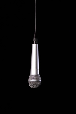 upside: upside down microphone isolated on black background