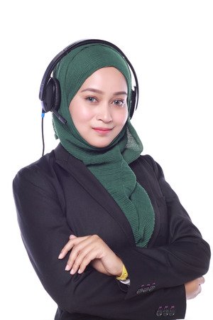 young muslim women helpline operator with headphones isolated on white background Banque d'images