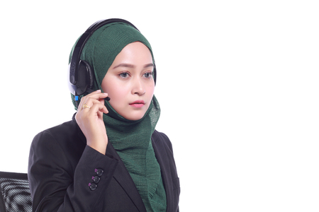 telecommute: young muslim women helpline operator with headphone isolated on white background