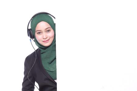 telecommute: young muslim woman helpline operator with white billboard Stock Photo
