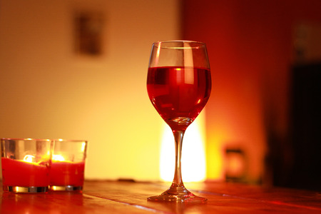 ambient light: red wine in glass with a living room background and and ambient light Stock Photo