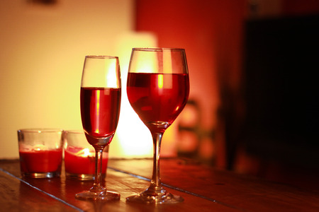 ambient: red wine in glass with a living room background and and ambient light Stock Photo