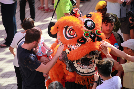 Kuala Lumpur, Malaysia - JANUARY 28, 2017. Local Chinese performing Lion Dance and get throng by the the visiter and foreigner at Thean Hou Temple during Chinese New Year celebration 2017.
